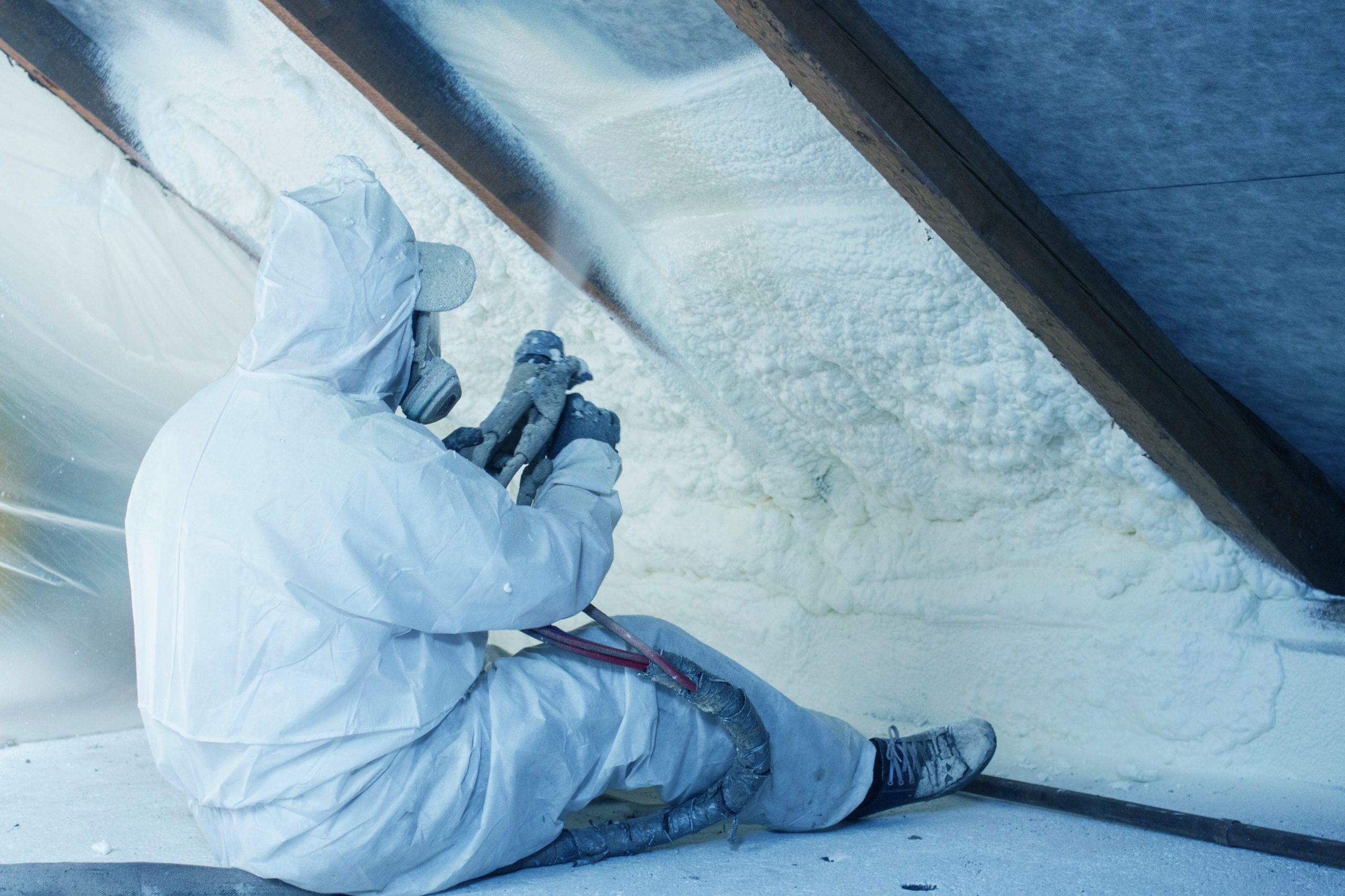 contractor performing spray foam insulation services