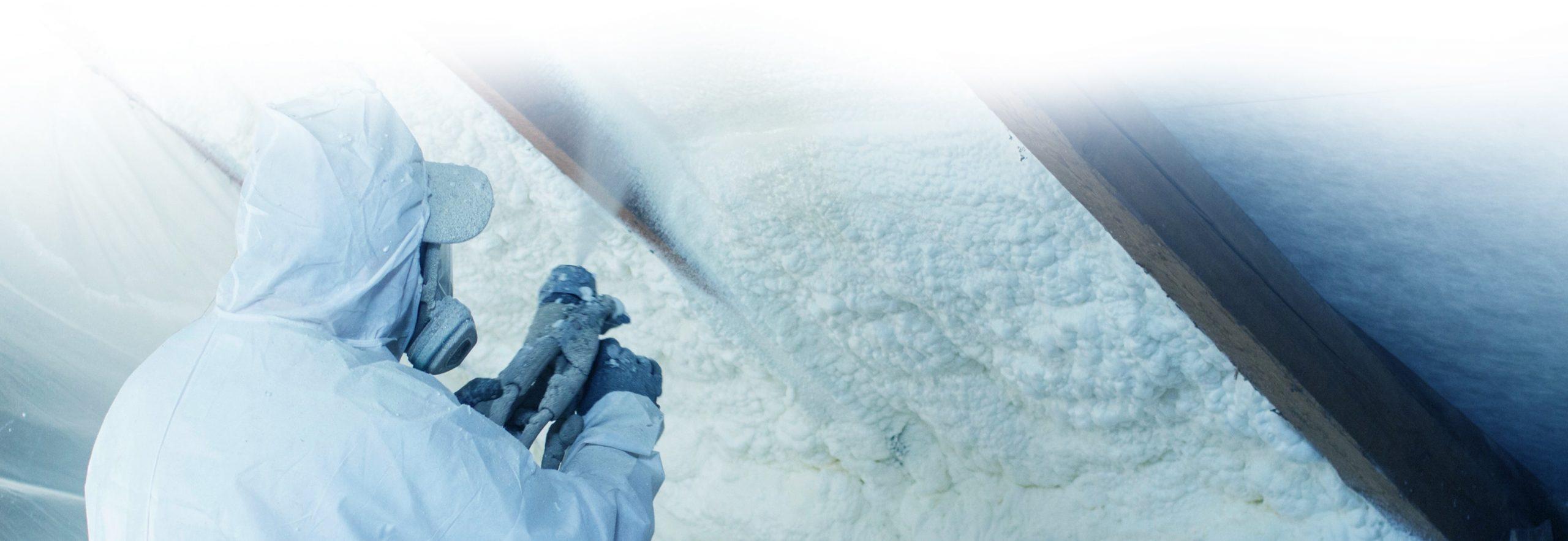Contractor performing spray foam insulation services